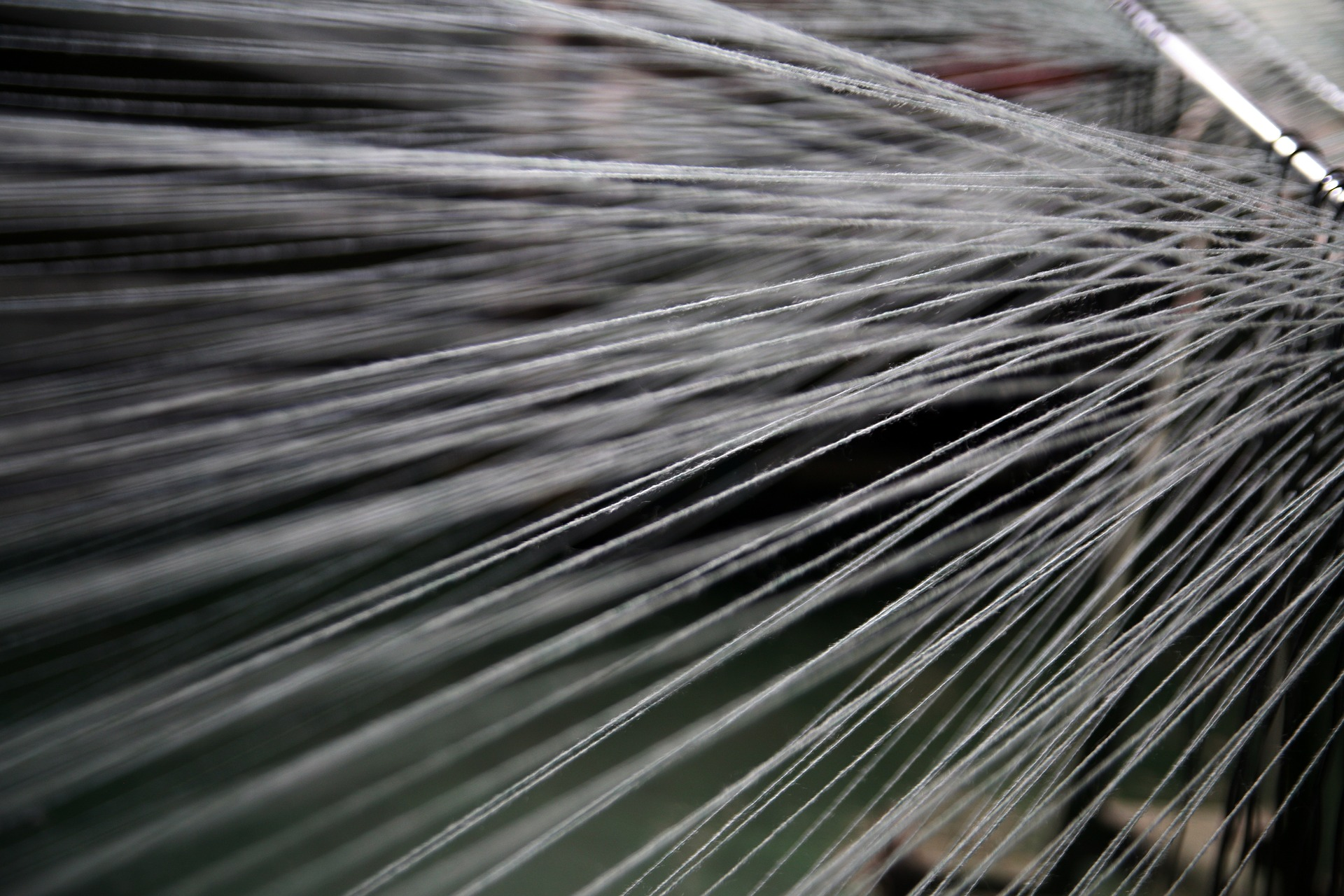 A photo of rug fibers being woven together